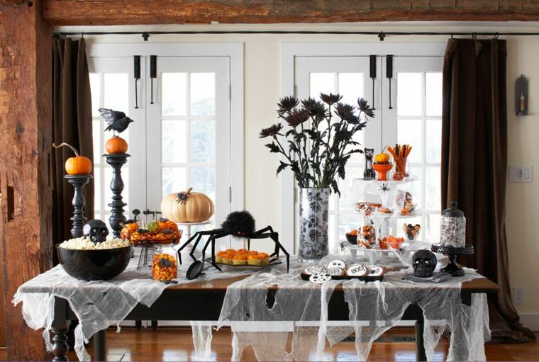 addobbi per halloween tavolo dolcumi ragno zucche