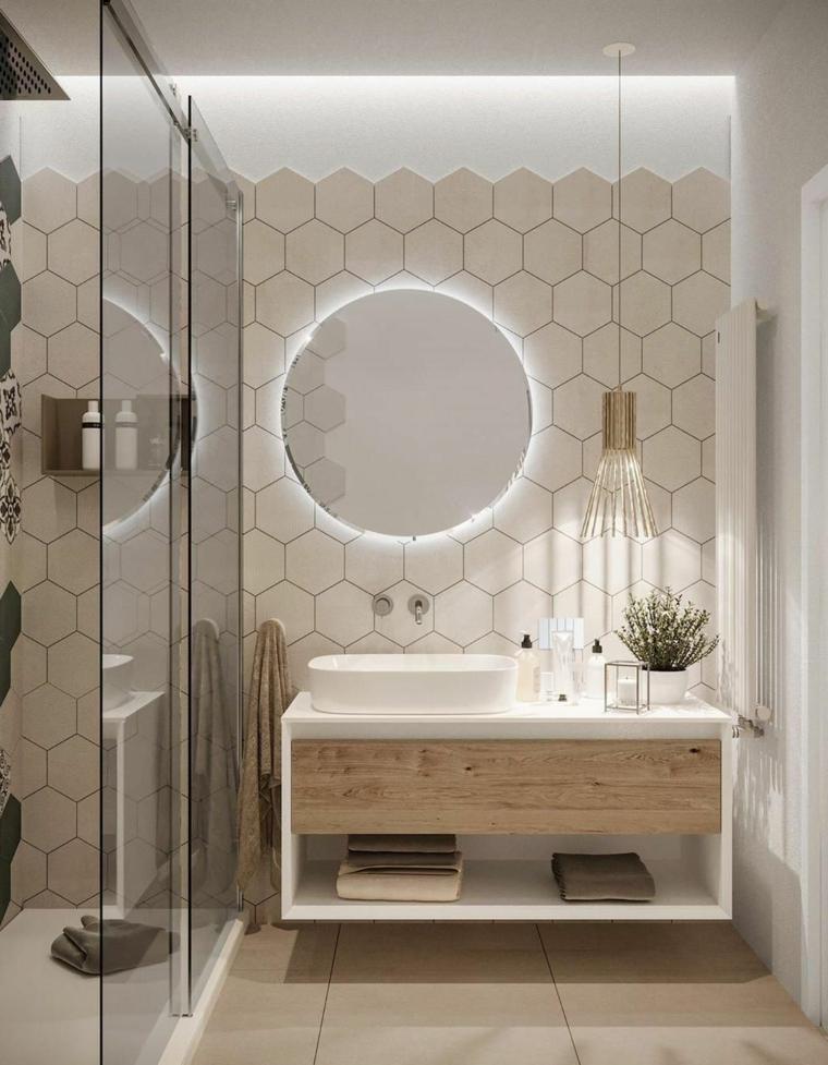Bagni piccoli con doccia e lavatrice, mobile con lavabo da appoggio e specchio retro illuminato