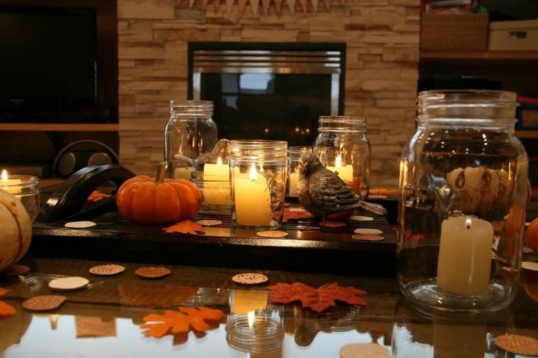 assemblaggio romantico zucca candele foglie