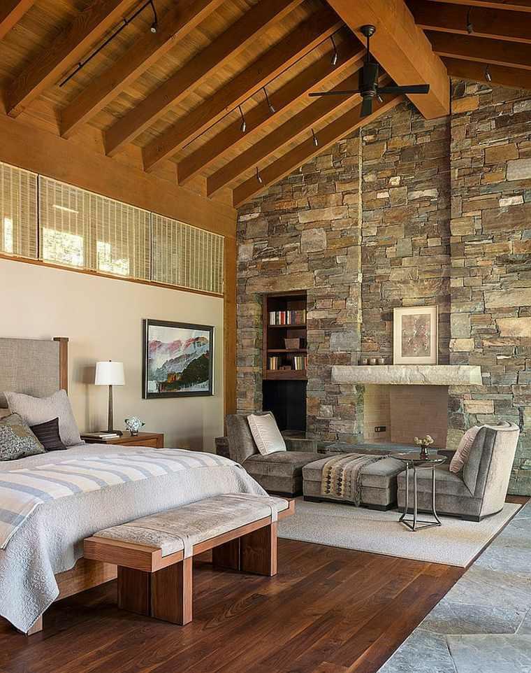 camera letto design accogliente abbinando muro pietra legno