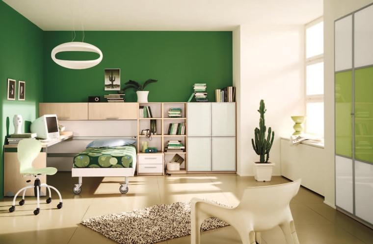 camera verde illuminata mensole libri piante