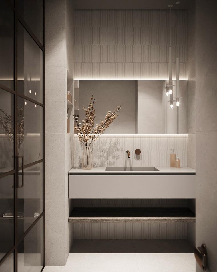 Rivestimenti bagni esempi, bagno con specchio retro illuminato, mobile con lavabo da incasso