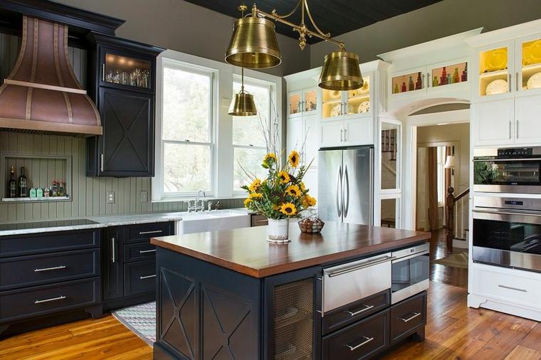 cucina con isola moderna accenti metallici