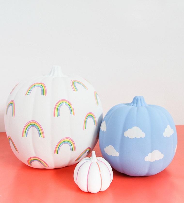 Zucche con disegni, foto zucche Halloween, disegno di arcobaleno, disegno nuvole