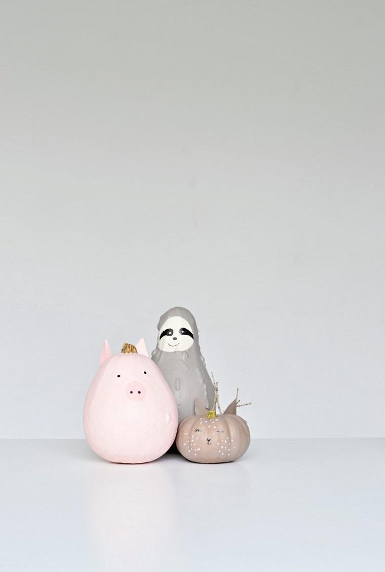 Foto zucche Halloween, disegno su zucche, decorazioni per Halloween con zucche disegnate