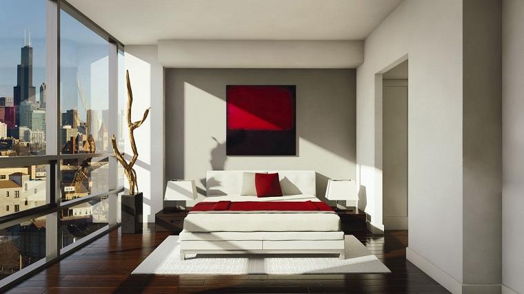 interior design stanza da letto cuscini quadro coperta rosso