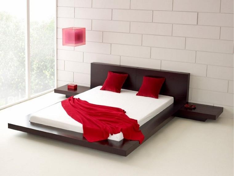 letto legno scuro ambiente minimalista