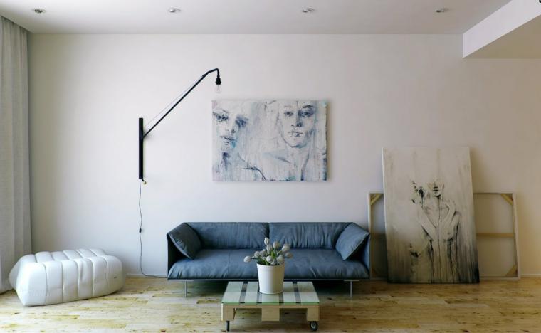 minimalismo arte design divano grigio puffo bianco quadri muri