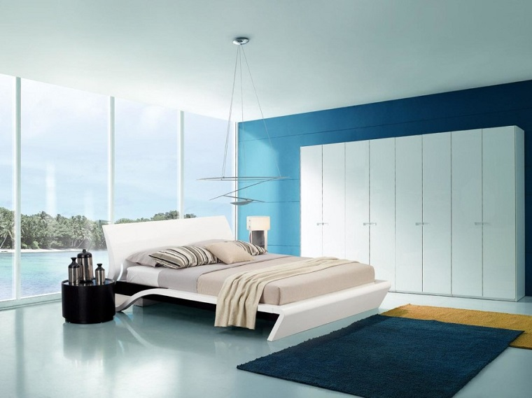 minimalismo stanza da letto armadio bianco tappeto scuro