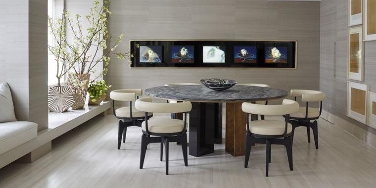 sala da pranzo tavola rotonda sedie imbottite