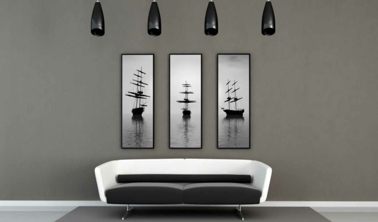 soggiorni moderni divano tre quadri lampade bianco nero grigio