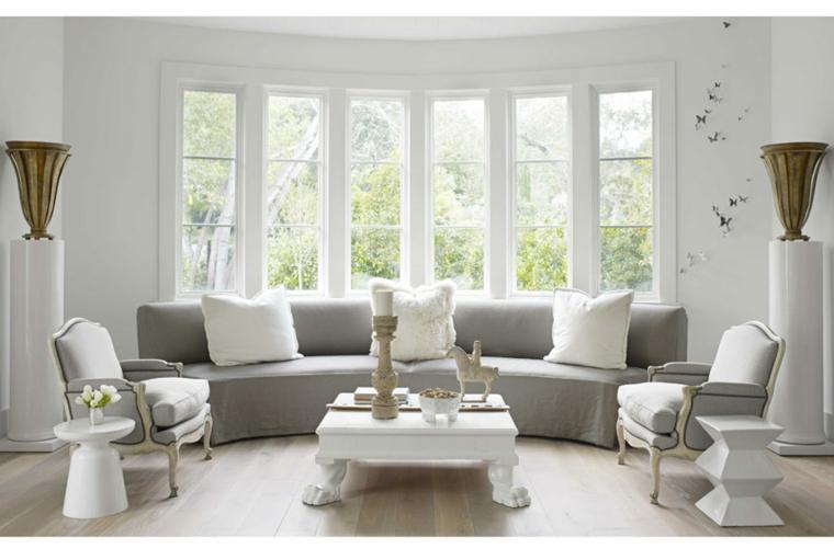 vintage tocco elegante vita moderna divano grigio curvato cuscini bianchi