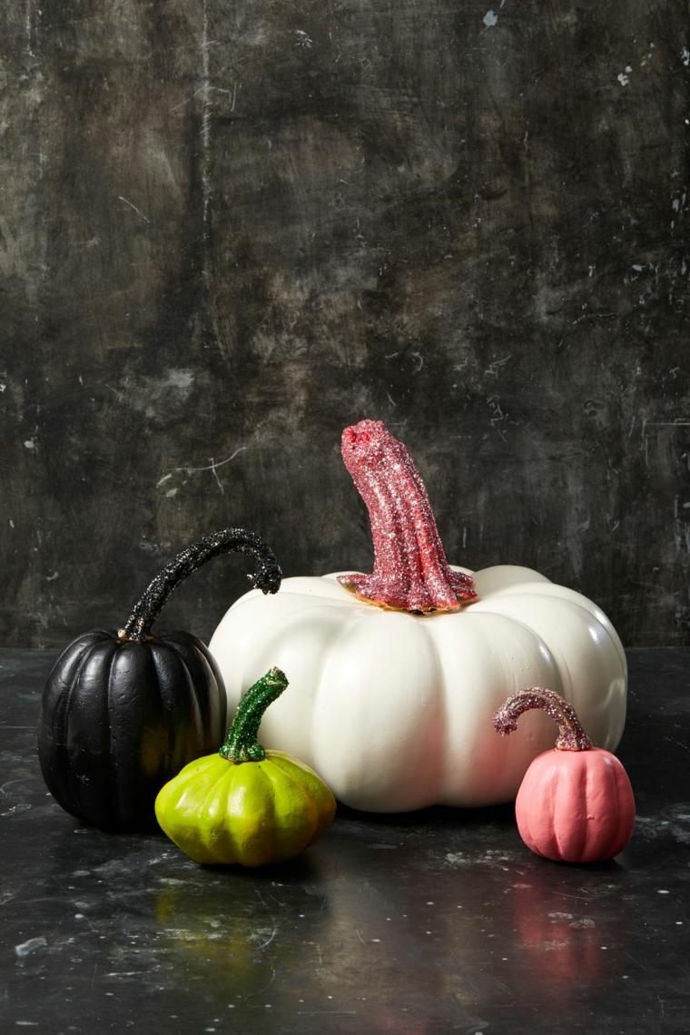 Zucca decorata con glitter, immagine con sfondo nero, zucca di Halloween