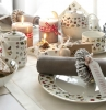 addobbi-natalizi-tavola-allestita-dolci-candele-segnaposto
