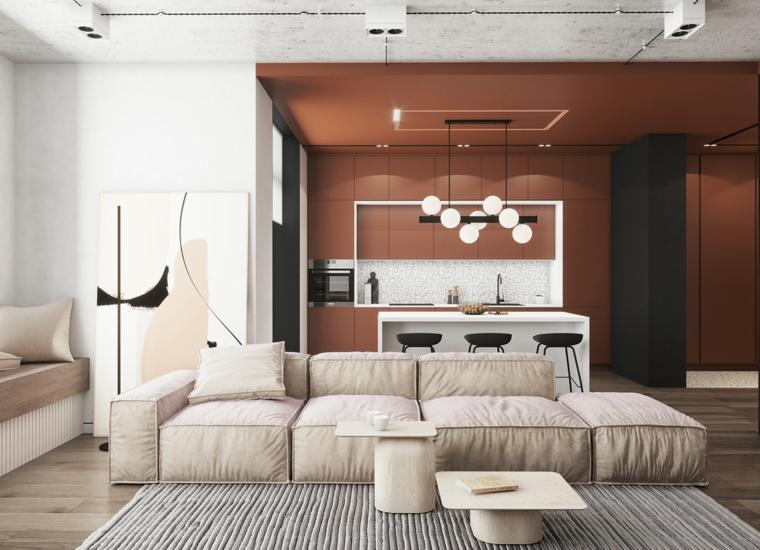 Mobili soggiorno componibili, divano in tessuto beige, cucina con isola centrale
