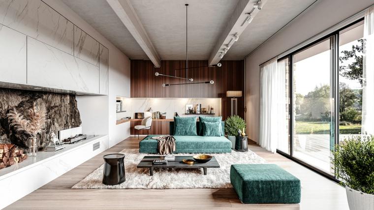 Divano in tessuto di colore verde, open space con cucina, idee pittura pareti soggiorno
