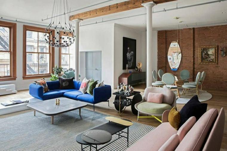 Mobili soggiorno componibili, divano angolare di colore blu, tavolino quadrato di legno
