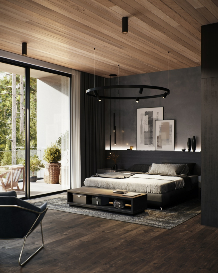 Lampadario anello colore nero, soffitto in legno con faretti, pavimento in legno, arredamento camera da letto