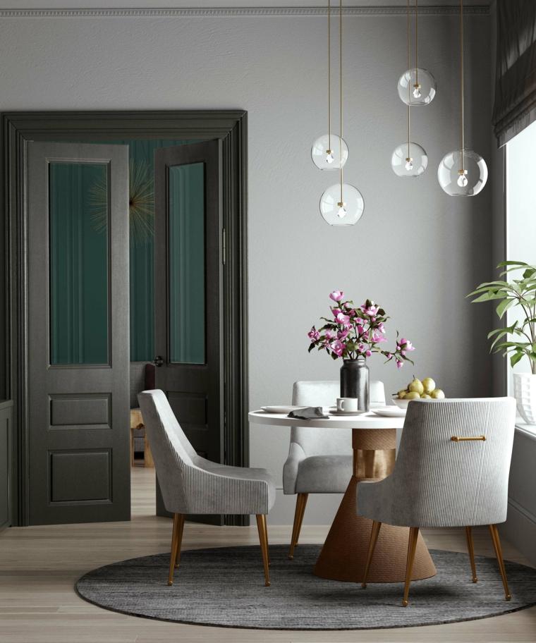 arredare piccolo soggiorno pranzo tavolo rotondo con sedie di colore grigio