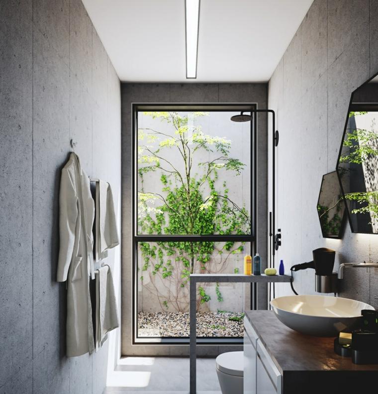 Mobile lavabo da appoggio, bagno con vista sul giardino rivestimento parete piastrelle grigie