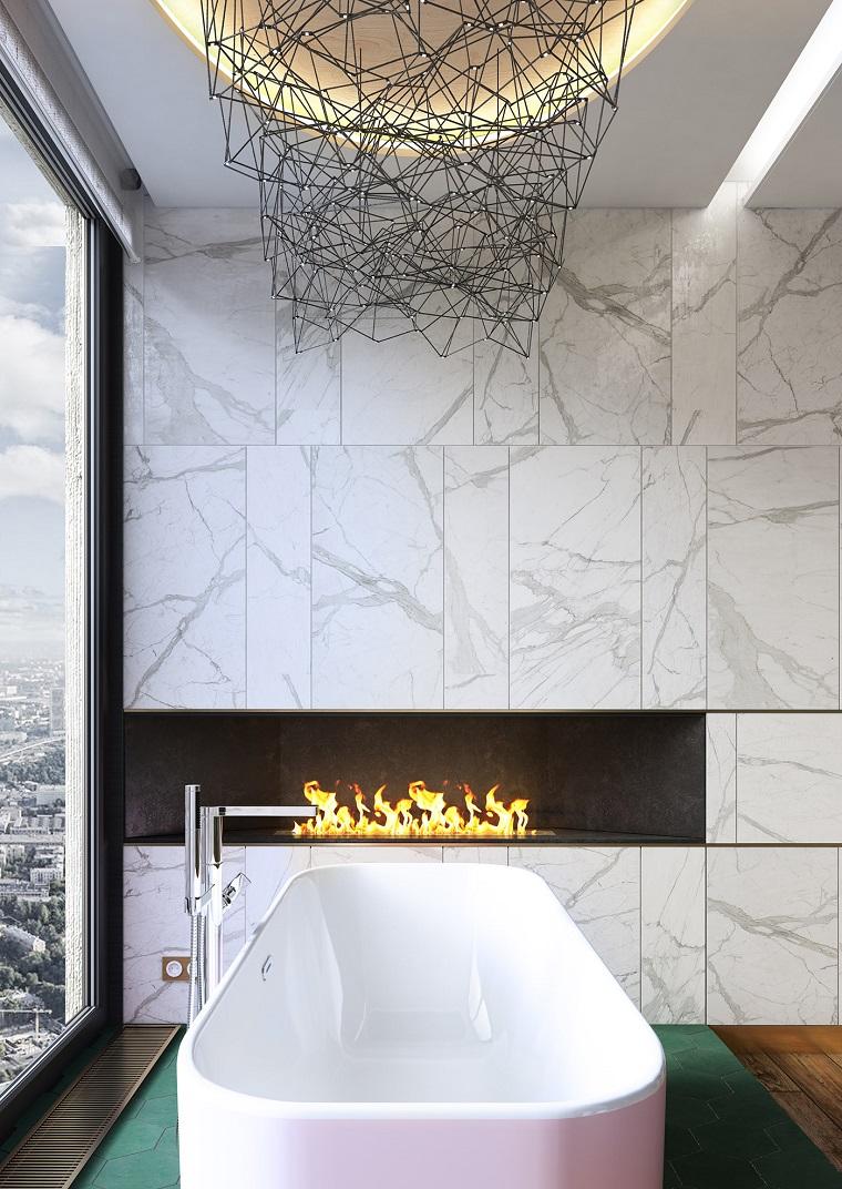 Ristrutturare bagno idee, vasca da bagno con angoli arrotondati, bagno con camino