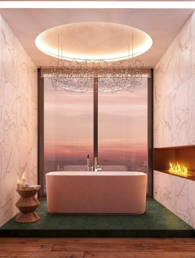 Sala da bagno con camino, vasca da bagno freestanding, ristrutturare bagno idee
