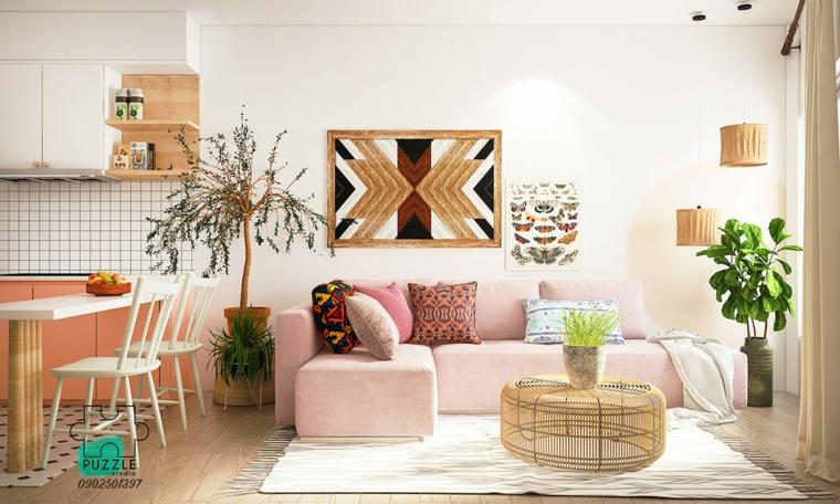 Arredamento casa moderno, open space con cucina e divano angolare di colore rosa