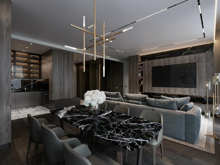 Arredare salotto e sala da pranzo insieme, un tavolo di marmo, lampadario con tubi di metallo