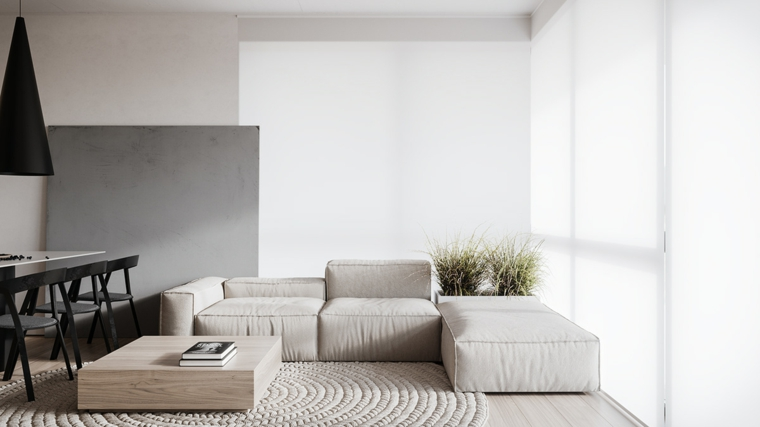 Mobili soggiorno componibili, divano in tessuto grigio, un tavolino basso di legno