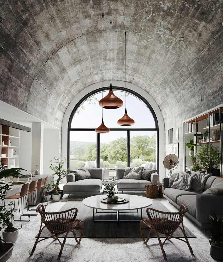 Due divani di colore grigio, cucina con isola centrale, arredamento casa moderno