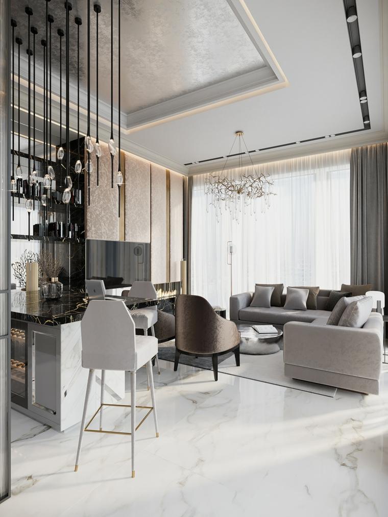 Come arredare sala e salotto insieme, lampadari sospesi dal soffitto, due divani di colore grigio