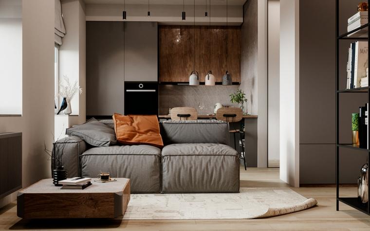 Salotto moderno, divano in tessuto grigio, tavolino basso in legno, cucina con tavolo