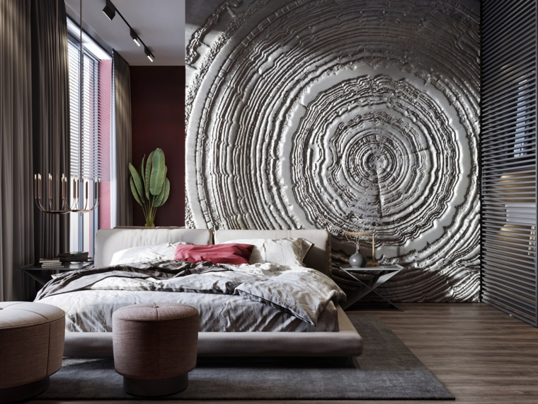 Parete effetto pietra con disegni, pavimento in legno, arredamento camera da letto
