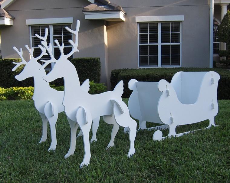 decorazioni natalizie esterno casa renne slitta legno