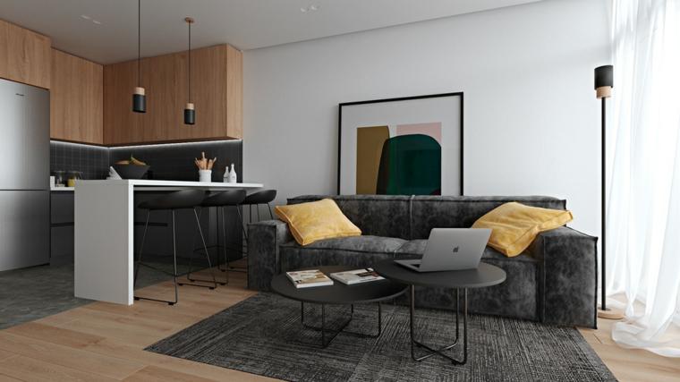 Mobili soggiorno componibili, divano di colore grigio in tessuto, cucina con isola centrale