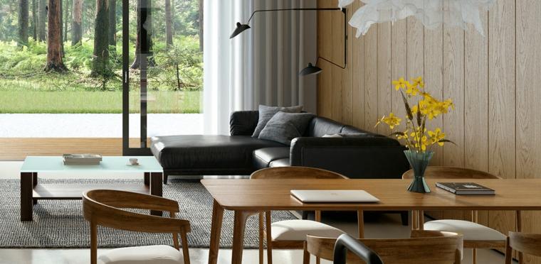Divano con isola di pelle nera, tavolo da pranzo in legno, come arredare un salotto