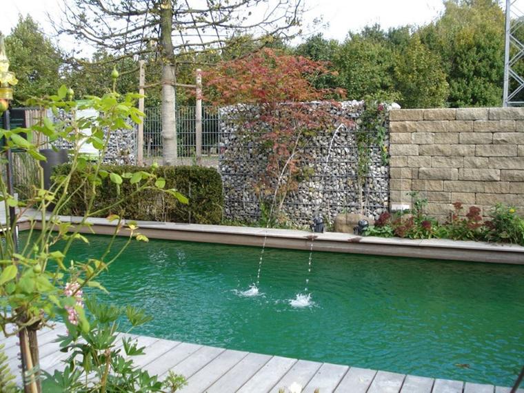 Gabbioni metallici utilizzati come recinzione tante idee - Recinzione piscina legno ...