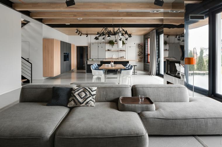 Come arredare sala e salotto insieme, un divano grigio con tavolino di legno