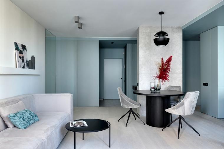 Come arredare sala e salotto insieme, parete dipinta di colore blu, tavolo da pranzo in legno