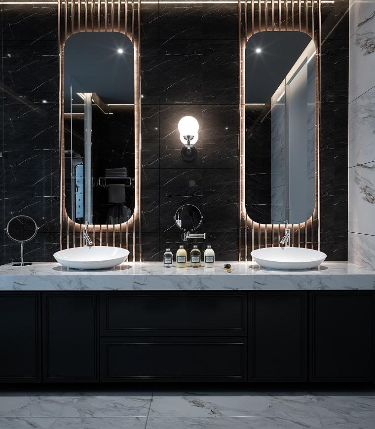 Mobile bagno con lavabo da appoggio, parete con piastrelle nere, pavimento in marmo bianco