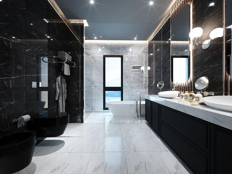 Sala da bagno con vasca e box doccia, mobile bagno con lavabo appoggio, pavimento in marmo