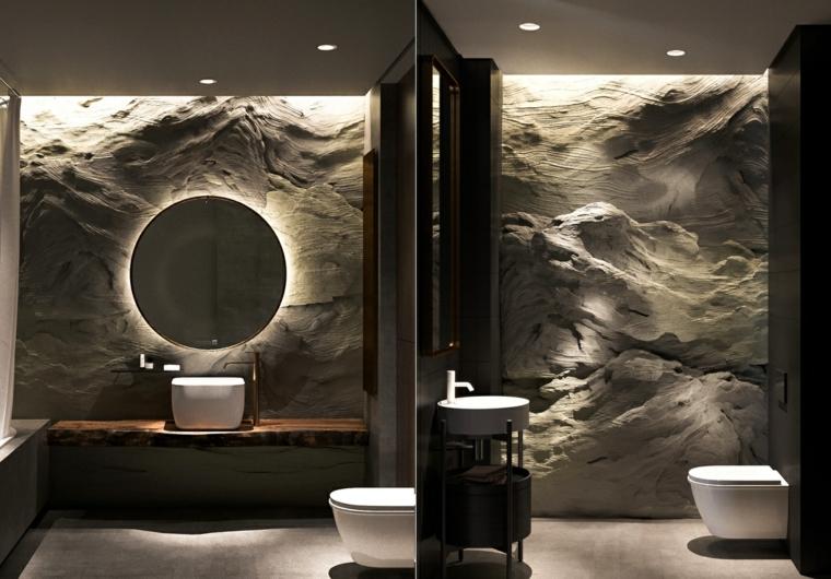 Parete di pietra, specchio rotondo illuminato, mobile per lavabo da appoggio