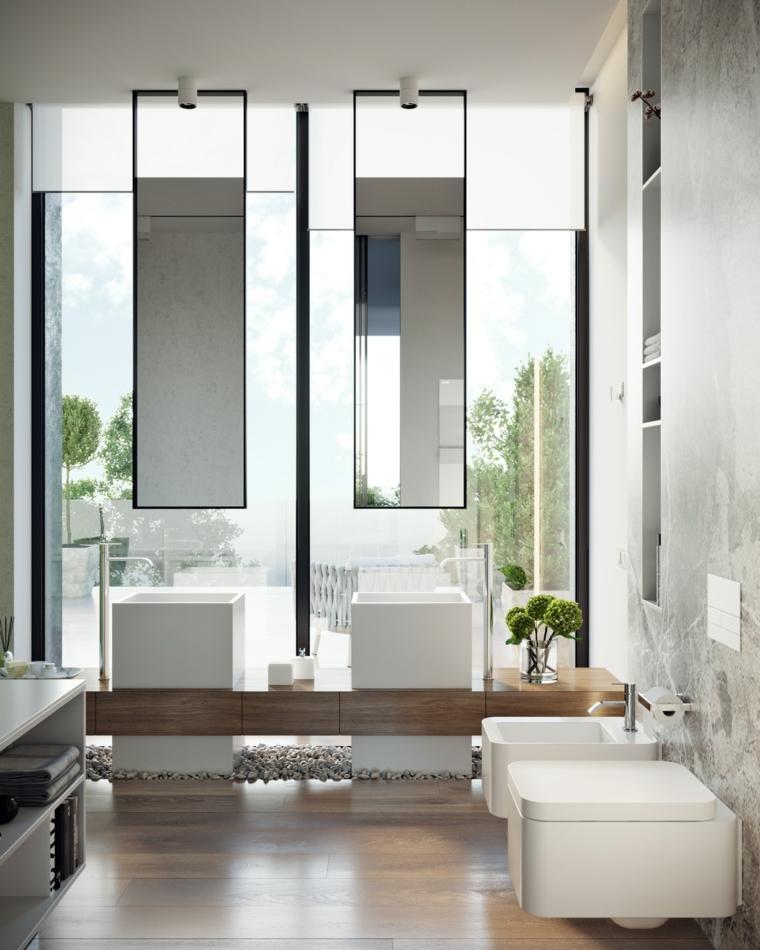 Bagno con sanitarie sospese, pavimento in legno parquet, due lavabi a colonna, bagni moderni grigi