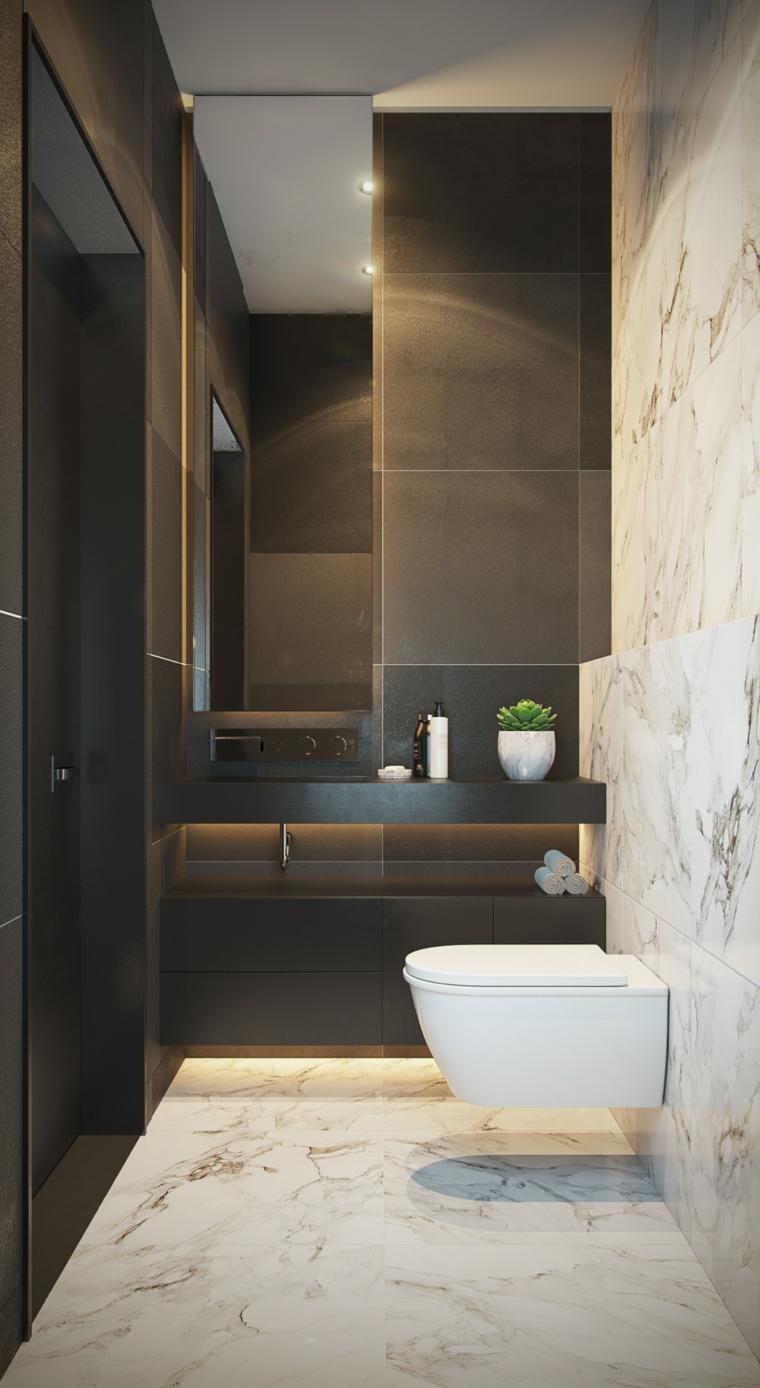 Bagno con sanitari sospesi, lavabo con piastrelle nere, pavimento in marmo