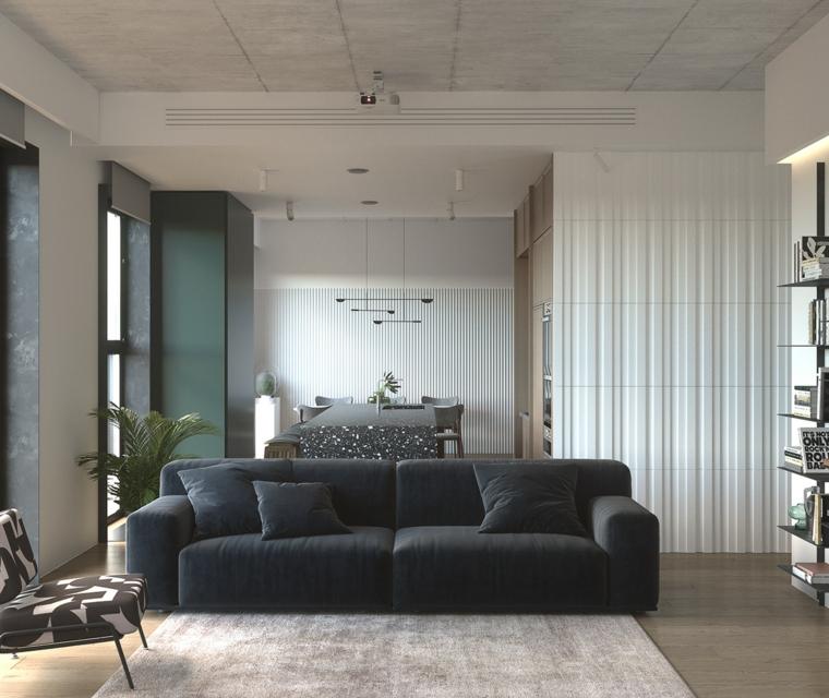 Idee pittura pareti soggiorno, divano in tessuto blu, pavimento in legno con tappeto