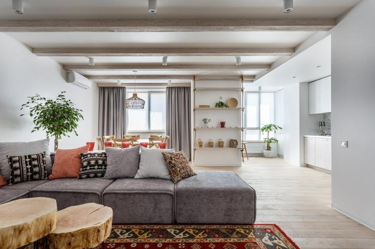 Arredare salotto e sala da pranzo insieme, divano di colore grigio in tessuto, open space con cucina