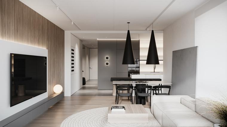 Un divano in tessuto accanto ad un tavolino, parete con rivestimento in legno, idee pittura pareti soggiorno