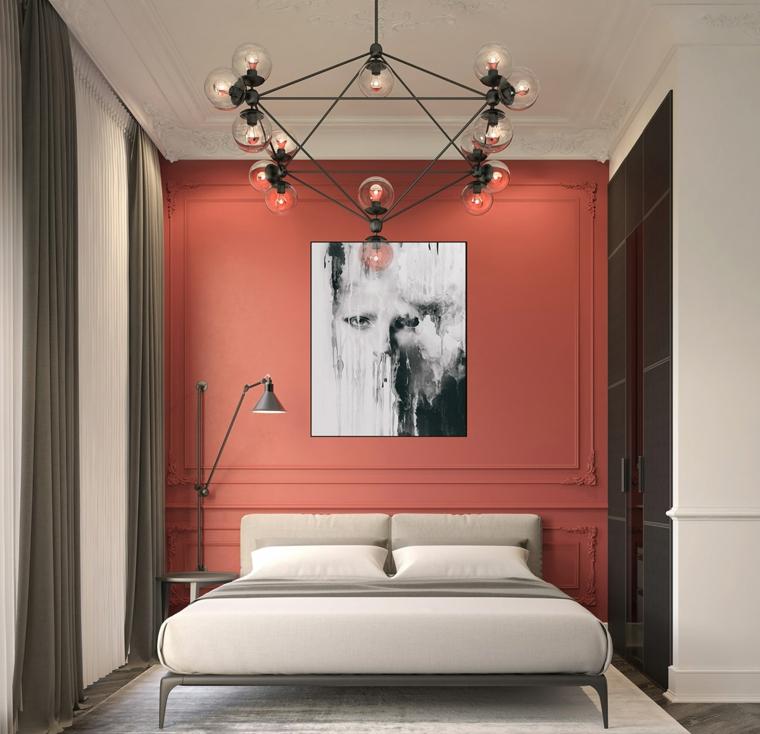 Arredare camera da letto piccola, parete dipinta di rosso, lampadario con sfere di vetro