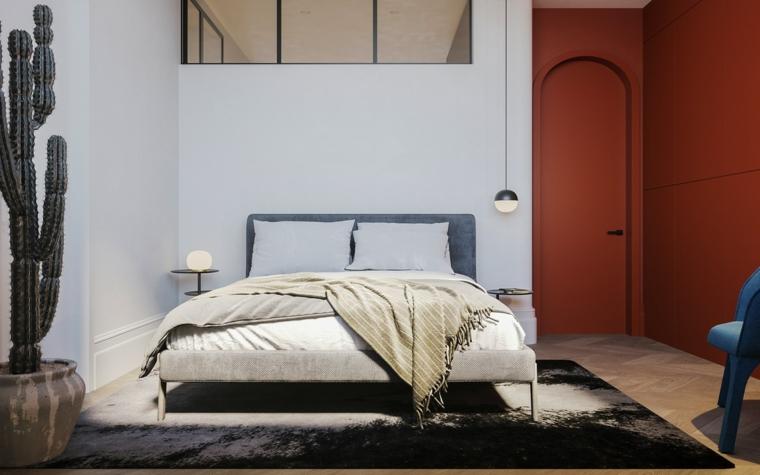 Arredare camera da letto piccola, pareti dipinte di rosso e bianco, tappeto peloso nero