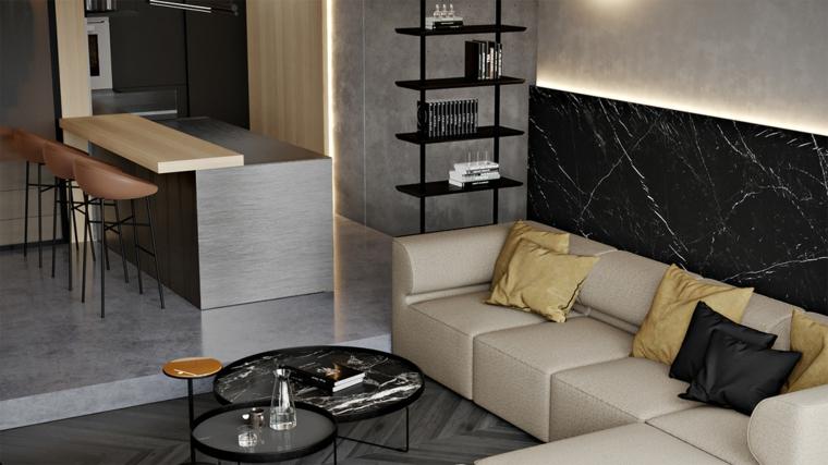 Open space con cucina e soggiorno, tavolini con superficie in marmo